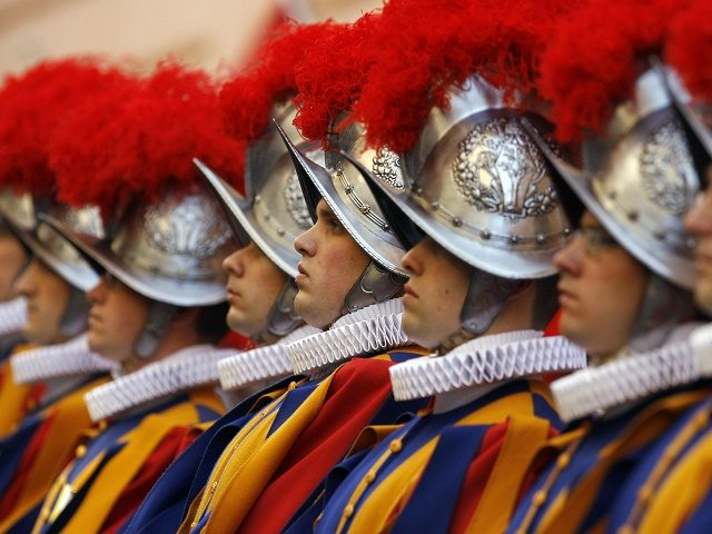 Vatican Swiss Guards stand to attention on May 6, 2008, at the Vatican. The ceremony is held each May 6 to commemorate the day in 1527 when 147 Swiss Guards died protecting Pope Clement VII during the Sack of Rome. AFP PHOTO/AP/Pool/Alessandra Tarantino (Photo credit should read ALESSANDRA TARANTINO/AFP/Getty Images)