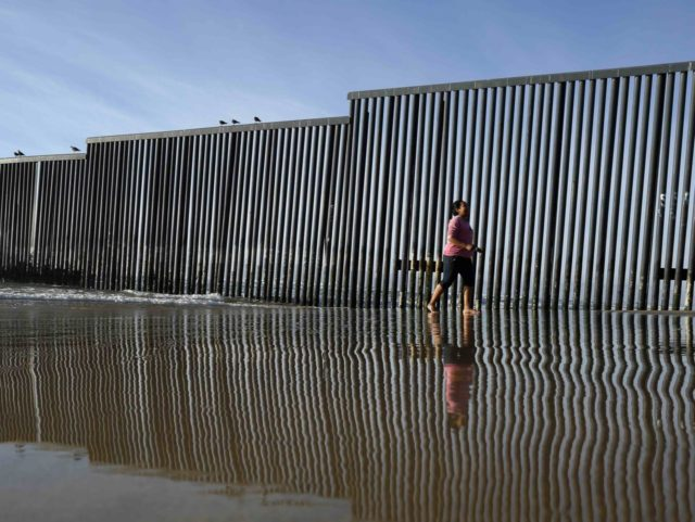 U.S.-Mexico border in ocean (Gregory Bull / Associated Press)