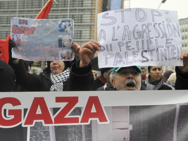 Protesters shout anti-Israeli slogans during a demonstration against the Israeli attacks on the Gaza Strip in front of the European headquarters on January 5, 2009 in Brussels. Some 100 Palestinian supporters called for the European Union to take action against Israel's military attack in Gaza, as EU envoys visited the …