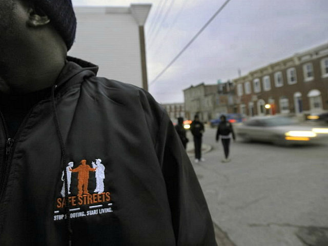 Outreach Supervisor Corey Winfield, with Safe Streets East, a violence intervention program in East Baltimore, 'canvases' the streets with other outreach workers to talk with people from the neighborhood to remind them that there are alternatives to violence, February 2, 2010. (Photo by Kenneth K. Lam/Baltimore Sun/MCT via Getty Images)