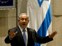 "Israel's Prime Minister Benjamin Netanyahu speaks during the opening session of the Knesset, Israel's parliament, in Jerusalem, Monday, Oct. 27, 2014. Netanyahu told parliament Monday that ""the French build in Paris, the English build in London and the Israelis build in Jerusalem."" The government is currently advancing construction plans to …"