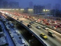 Cars drive along a bridge after snowfall in Urumqi, Xinjiang Autonomous region, in this November 28, 2014 file photo. REUTERS/Stringer