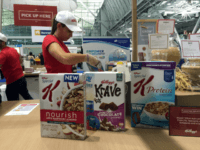 "This Oct. 16, 2016, file photo shows the Kellogg booth at an annual dietitians' conference, where company representatives explained the health benefits of their products, in Boston. On its website, amid news of Pop-Tarts and Frosted Flakes, Kellogg touted a distinguished-sounding ""breakfast council"" of ""independent experts"" dedicated to guiding its …"