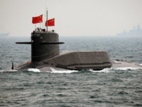 TSINGTAO - APRIL 23: A Chinese Navy submarine attends an international fleet review to celebrate the 60th anniversary of the founding of the People's Liberation Army Navy on April 23, 2009 off Qingdao in Shandong Province. Fifty-six Chinese subs, destroyers, frigates, missile boats and planes were displayed off the eastern port city of Qingdao just weeks after tensions flared following a naval stand-off with the United States in the South China Sea. POOL (Photo by Guang Niu/AFP/Getty Images)