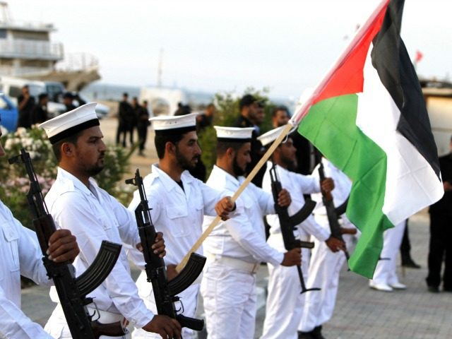 Hamas naval police show arms as they hold a ceremony for the nine victims who were shot dead during an Israeli raid on Gaza-bound aid ships in the Gaza City port on June 06, 2010, a week after an international aid flotilla was raided by Israeli commandos as the ships …