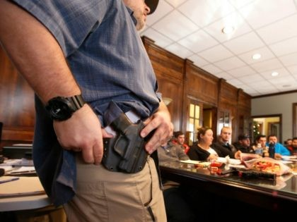 Damon Thueson shows a holster at a gun concealed carry permit class put on by 'USA Firearms Training' on December 19, 2015 in Provo, Utah. Demand for concealed carry permits have spiked in the last several weeks with the terrorists attacks in Paris and the United States. (Photo by George …