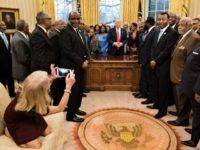 Counselor to the President Kellyanne Conway takes a photo as US President Donald Trump and leaders of historically black universities and colleges talk before a group photo in the Oval Office of the White House before a meeting with US Vice President Mike Pence February 27, 2017 in Washington, DC. …
