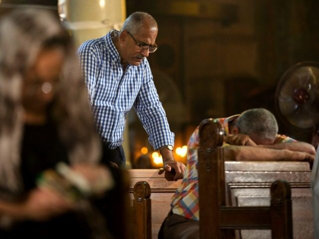 Coptic Christians grieve during prayers for the departed remembering the victims of EgyptAir flight 804 at Al-Boutrossiya Church, the main Coptic Cathedral complex, in Cairo, Egypt, Sunday, May 22, 2016. The Airbus A320 plane was flying from Paris to Cairo with 66 passengers and crew when it disappeared early last …