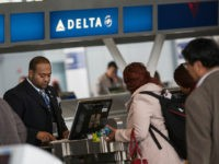 NEW YORK, NY - APRIL 23: Customers check in at Delta's counter at John F. Kennedy Airport on April 23, 2014 in the Queens borough of New York City. Delta released higher-than-expected quarterly earnings today, causing its stock to rise 5%. (Photo by Andrew Burton/Getty Images)
