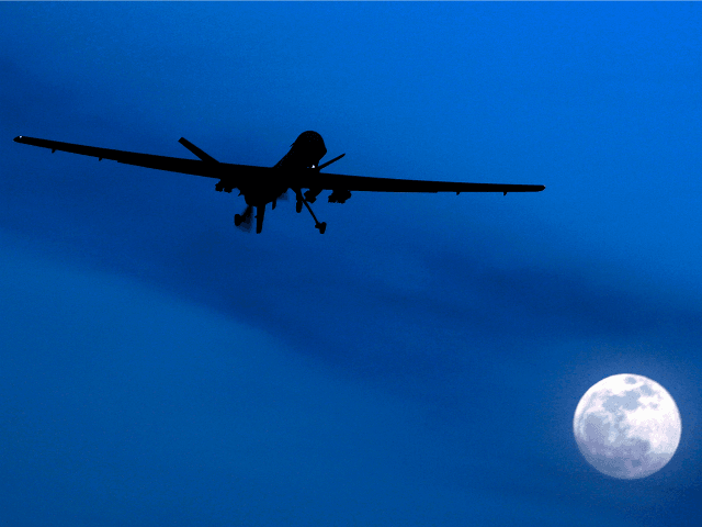 In this Jan. 31, 2010 file photo, an unmanned U.S. Predator drone flies over Kandahar Air Field, southern Afghanistan, on a moon-lit night. A U.N. expert on Friday, Oct. 18, 2013 called on the United States to reveal the number of civilians it believes have been killed by American drone …