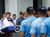 In this photo provided by the Presidential Photographers Division, Malacanang Palace, Philippine President Rodrigo Duterte, left, berates erring policemen during an audience at the Presidential Palace grounds in Manila, Philippines, Tuesday, Feb. 9, 2017. Duterte angrily berated more than 200 allegedly erring policemen and said he would send them to …