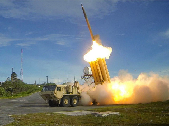 FILE PHOTO - A Terminal High Altitude Area Defense ( THAAD ) interceptor is launched during a successful intercept test, in this undated handout photo provided by the U.S. Department of Defense, Missile Defense Agency. U.S. Department of Defense, Missile Defense...