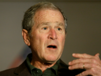 Former President George W Bush speaks during a preview of an exhibition of his paintings of U.S. military veterans in Dallas, Tuesday, Feb. 28, 2017. President Bush says he didn't intend to criticize President Donald Trump when he said recently that a free press is essential to democracy. (AP Photo/LM …