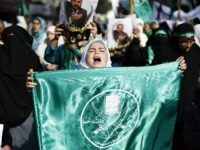 A girl carries a flag of the Muslim Brotherhood as she joins protesters from the Islamic Action Front during demonstration to show their solidarity with Palestinians and anger at a recent political arrest, after the Friday prayer in Amman November 28, 2014. REUTERS/Muhammad Hamed
