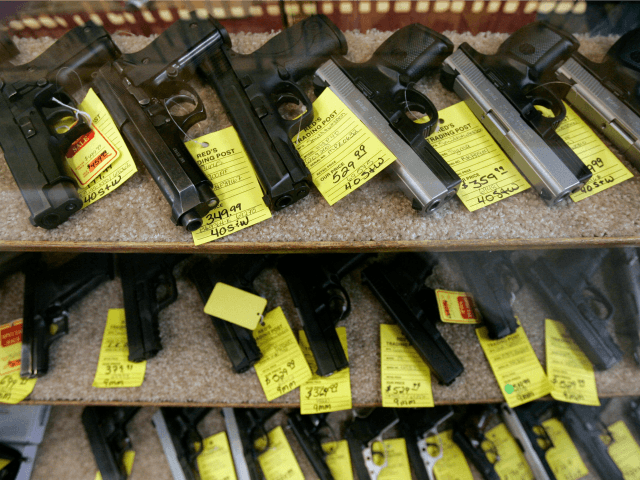 Handguns fill a display case at Red's Trading Post Feb. 12, 2008, in Twin Falls, Idaho. The gun shop, stripped of its license by the Bureau of Alcohol, Tobacco, Firearms and Explosives, had repeated chances to fix problems but failed to, bureau inspector John Hansen testified in federal court Tuesday, …