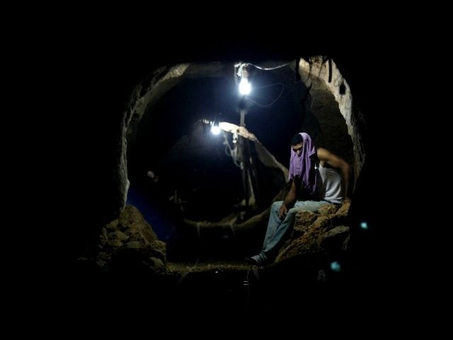 FILE - In this Monday, Sept. 30, 2013 file photo, a Palestinian worker rests inside a smuggling tunnel in Rafah, on the border between Egypt and the southern Gaza Strip. Renewed Israel-Hamas fighting after the collapse of truce talks in Cairo on Tuesday, Aug. 19, 2014 highlights the steep obstacles …