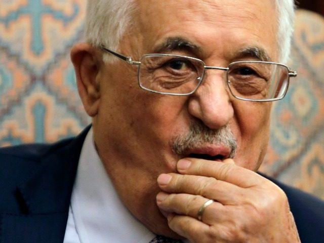 In this Wednesday, July 16, 2014, file photo, Palestinian President Mahmoud Abbas listens to Arab League Secretary General Nabil Elaraby during a meeting in Cairo. A Monday, March 21, 2016 poll, indicates that a majority of Palestinians back near-daily stabbing attacks on Israelis, but that support dropped by nine points …