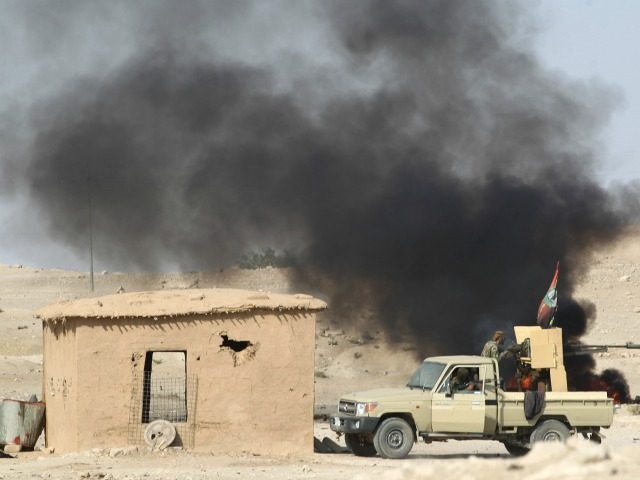 A picture taken on October 29, 2016 shows smoke billowing following a car bomb attack as Iraqi forces and the Hashed al-Shaabi (Popular Mobilisation) hold a position near the village of Ayn Nasir, south of Mosul, during the ongoing battle against Islamic State group jihadists to liberate the city of …