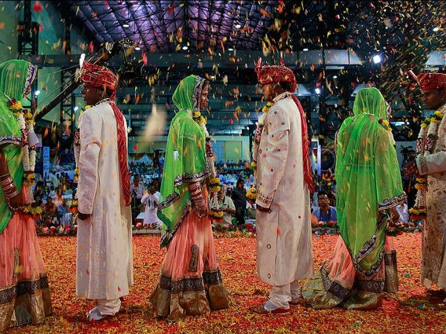Underprivileged and specially abled couples take part in a mass wedding where 51 couple got married in Mumbai, India, Sunday, May 29, 2016. Mass weddings in India are organized by social organizations primarily to help the economically backward families who cannot afford the high ceremony costs as well as the …