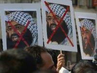Indian activists carry placards of the chief of Jaish-e-Mohammad, Maulana Masood Azhar during a protest against the attack on the air force base in Pathankot, in Mumbai on January 4, 2016. Indian troops backed by helicopters searched an air force base January 4, after a weekend of fierce fighting with …