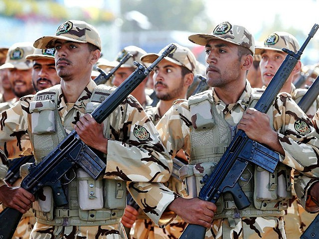 Iranian armed forces members march in a military parade marking the 36th anniversary of Iraq's 1980 invasion of Iran, in front of the shrine of late revolutionary founder Ayatollah Khomeini, just outside Tehran, Iran, Wednesday, Sept. 21, 2016. Iran's chief of staff of the armed forces said Wednesday a $38 billion aid deal between the United States and Israel makes Iran more determined to strengthen its military. (AP Photo/Ebrahim Noroozi)