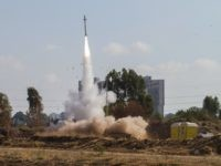 "In this July 9, 2014 file photo, an Iron Dome air defense system fires to intercept a rocket from the Gaza Strip in Tel Aviv, Israel. Israel's ""Iron Dome"" defense system has emerged as a game-changer in the current round of violence with Hamas militants in the Gaza Strip, shooting …"