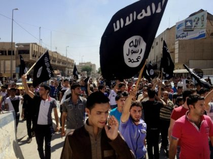 In this June 16, 2014 file photo, demonstrators chant pro-Islamic State group, slogans as they carry the group's flags in front of the provincial government headquarters in Mosul, 225 miles (360 kilometers) northwest of Baghdad. ISIS placed eighth on Google's list of 2014's fastest-rising global search requests, the company said …