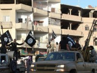 An image made available by Jihadist media outlet Welayat Raqa on June 30, 2014, allegedly shows a member of the IS (Islamic state) militant group parading in a street in the northern rebel-held Syrian city of Raqa. AFP PHOTO / HO / WELAYAT RAQA === RESTRICTED TO EDITORIAL USE - …