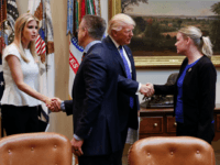 President Donald Trump greets Holly Gibbs, a survivor of human trafficking and director of Dignity Health's Human Trafficking response Program, as his daughter Ivanka Trump greets Gary Haugen, CEO and founder of International Justice Mission, prior to the start of a meeting on domestic and international human trafficking, Thursday, Feb. …