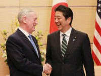 US Defense Secretary James Mattis (L) and Japanese Prime Minister Shinzo Abe (R) shake hands at the prime minister's office in Tokyo on February 3, 2017. Any nuclear attack by North Korea would trigger an 'effective and overwhelming' response, US Defence Secretary James Mattis said February 3 as he sought to reassure Asian allies rattled by President Donald Trump's isolationist rhetoric. / AFP / POOL / Eugene Hoshiko (Photo credit should read EUGENE HOSHIKO/AFP/Getty Images)