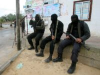 Islamic Jihad militants rest during the funeral of Haytham Arafat, in Khan Younis, southern Gaza Strip, Saturday, March 27, 2010. Israel withdrew its troops from the Gaza Strip Saturday after some of the fiercest gunbattles with Palestinian militants in the Hamas-run territory since last year's military offensive. Israeli troops used …