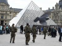 French soldiers enforcing the Vigipirate plan, France's national security alert system, patrol in front of the Louvre museum the day of its reopening on November 16, 2015 in Paris, three days after a series of deadly coordinated attacks claimed by Islamic State jihadists, which killed at least 129 people and …