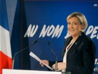 Far-right leader and candidate for next spring presidential elections Marine le Pen, arrives for her New Year's address to the media in Paris, Wednesday, Jan. 4, 2017. French far right presidential candidate Marine Le Pen is cheering Ford Motor Co.'s decision to shift investment from Mexico to the U.S., calling …