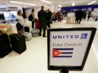Passengers wait in line to check in for United Flight 1502 for the first direct passenger flight from Newark Liberty International Airport to Havana, Cuba, Tuesday, Nov. 29, 2016, in Newark, N.J. Commercial flights between the United States and Cuba resumed several months ago as relations between the two countries …