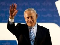 Israel's Prime Minister Benjamin Netanyahu waves to his governing Likud Party members during the Likud convention in Tel Aviv, Israel, Monday, Oct. 29, 2012. Israel's governing Likud Party has approved a merger with an ultranationalist rival, forming a hawkish bloc that appears poised to sweep upcoming parliamentary elections. The move …