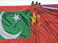 Pakistani labourers arrange a welcome billboard featuring the Chinese and Pakistani national flags ahead of the forthcoming visit by Chinese President Xi Jinping in Islamabad on April 18, 2015. Pakistan needs a 'huge amount of financing' for infrastructure and energy projects and China is ready to announce help when President Xi Jinping visits next week, a foreign ministry official said April 17, 2015. AFP PHOTO / Farooq NAEEM (Photo credit should read FAROOQ NAEEM/AFP/Getty Images)