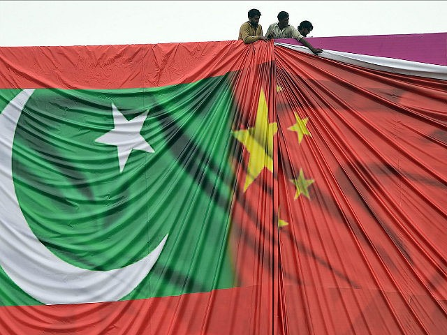 Pakistan labourers arrange a welcome billboard featuring the Chinese and Pakistani national flags ahead of the forthcoming visit by Chinese President Xi Jinping in Islamabad on April 18, 2015. Pakistan needs a 'huge amount of financing' for infrastructure and energy projects and China is ready to announce help when President …