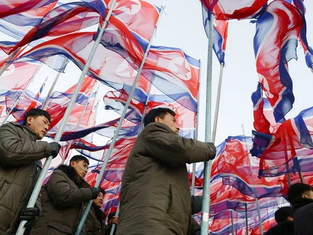 "People march carrying flags of North Korea's Workers' Party during a rally in Pyongyang on Feb. 25, 2016, for a ""70-day battle"" ahead of the 7th Party Congress in May. (Kyodo via AP Images) ==Kyodo"