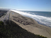 Anti-Trump Protesters Gather on San Francisco Beach to Spell Out ' RESIST !!'