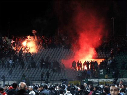 FILE - In this Feb. 1, 2012 file photo, Egyptian fans rush onto the field and clash in the stands following an Al-Ahly club soccer match against Al-Masry club at the soccer stadium in Port Said, Egypt. On Monday, Feb. 20, 2017, Egypt's highest appeals court upheld the death sentences …