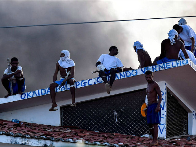 Reuters / Thursday, January 19, 2017 Inmates are seen on a roof during an uprising at the Alcacuz prison in Natal, Rio Grande do Norte state, Brazil. REUTERS/Josemar Goncalves