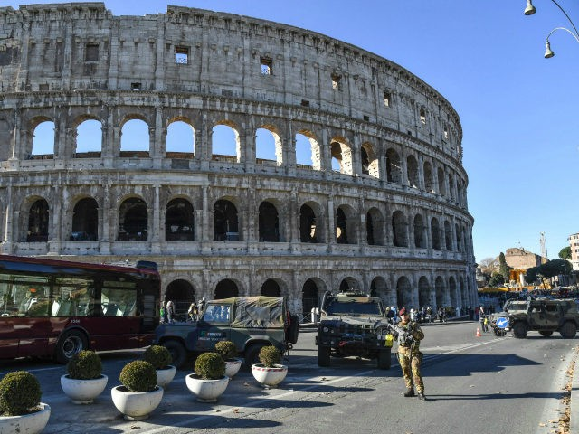 Italian military corps stand guard at a security check-point in front of ancient Colosseum, in central Rome on December 29, 2016. / AFP / Andreas SOLARO (Photo credit should read ANDREAS SOLARO/AFP/Getty Images)