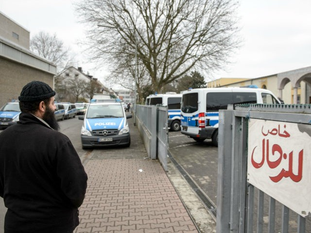 FRANKFURT AM MAIN, GERMANY - FEBRUARY 01: A Muslim man stands outside the Bilal mosque in Griesheim district while police investigate inside on February 1, 2017 in Frankfurt, Germany. Approximately 1,000 police officers were involved in the anti-terror raids of 54 residences, apartments and businesses across the state of Hesse. …