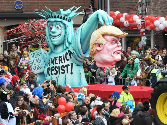 A float showing US president Donald Trump and the Statue of Liberty are seen at the Rose Monday carnival parade in Duesseldorf, Germany on February 27, 2017. / AFP / PATRIK STOLLARZ (Photo credit should read PATRIK STOLLARZ/AFP/Getty Images)
