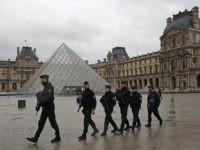 "Armed police officers patrol in the courtyard of the Louvre museum near where a soldier opened fire after he was attacked in Paris, Friday, Feb. 3, 2017. A knife-wielding man shouting ""Allahu akbar"" attacked French soldiers on patrol near the Louvre Museum Friday in what officials described as a suspected …"