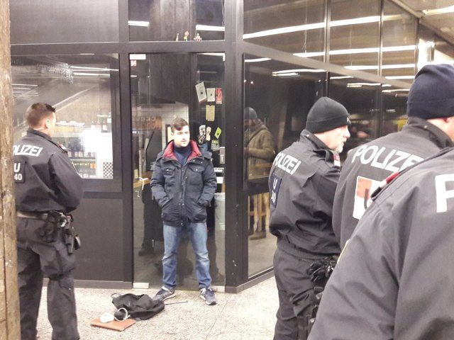 Austrian Identitarian leader Martin Sellner talks to police after being attacked by left-wing extremists.