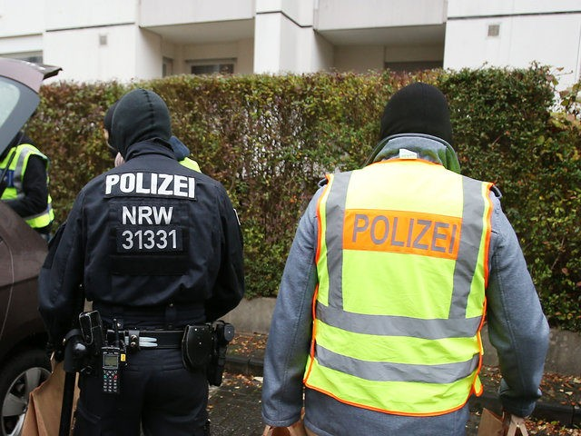 Policemen carry confiscated pieces of evidence to their car after raiding an apartment building in Bonn, western Germany, on November 15, 2016. German police said it carried out sweeping raids across 10 states in a probe against an Islamist group suspected of propagating hate and inciting youths to fight alongside …