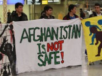 Demonstrators protest against the deportation of refugees back to Afghanistan at the airport in Frankfurt/Main on December 14, 2016. / AFP / Daniel ROLAND (Photo credit should read DANIEL ROLAND/AFP/Getty Images)
