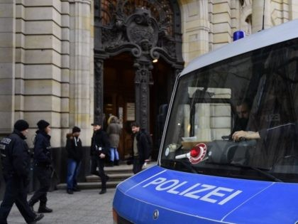 Policemen secure the area in front of Berlin's Supreme Court, where is starting a trial against alleged Islamic State jihadist Shaas Al Mohammad on January 4, 2017 in Berlin. The defendant, a 19-year-old Syrian national, is accused of scoping out potential targets for an attack in Berlin, including the Brandenburg …