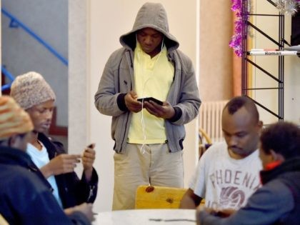 "A migrant looks at his cell phone in a ""Centre dAccueil et dOrientation pour migrants"" (CAO - Reception and Orientation Center for Migrants) on January 4, 2017 in Saint-Brevin-les-Pins, western France. / AFP / LOIC VENANCE (Photo credit should read LOIC VENANCE/AFP/Getty Images)"